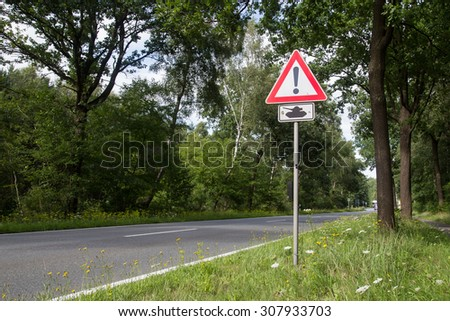 Photograph of a road sign warning for crossing tanks. - stock photo