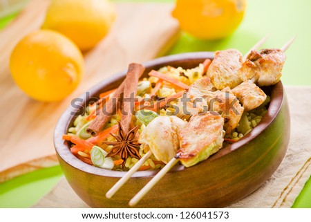 Photograph of a tasty bowl of chicken curry with rice - stock photo
