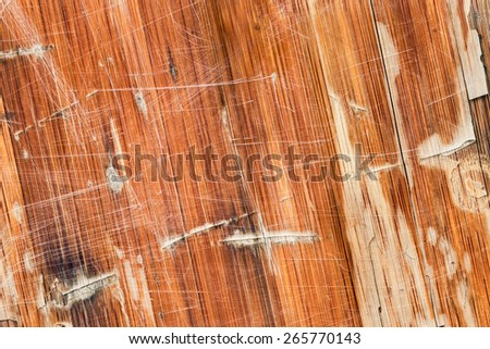 Photograph of obsolete old, varnished, weathered Wooden Laminated Panel, cracked, scratched, grunge texture. - stock photo