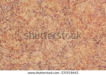 Photograph of Recycle Kraft Brown Paper, coarse grain, blotted, mottled, spotted, grunge texture. - stock photo
