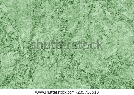 Photograph of Recycle Kraft Kelly Green Paper, coarse grain, blotted, mottled, spotted, grunge texture. - stock photo