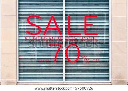 photograph of 70% sale sign on a shop window - stock photo
