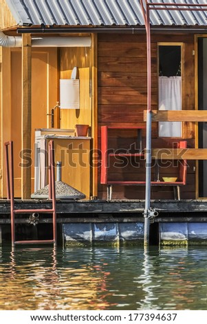 Photograph represents detail of an old, handmade wooden hut, placed among many, side by side, along the Sava river banks, Belgrade - Republic of Serbia. - stock photo