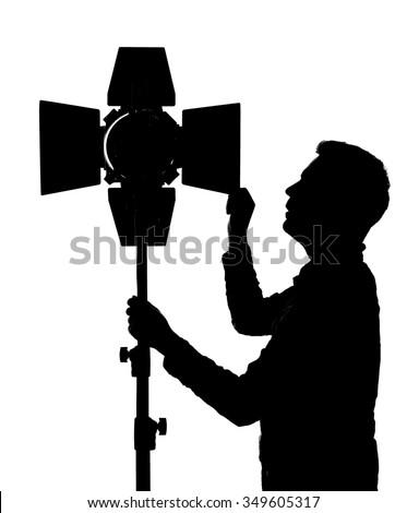 Photographer controls lighting equipment for photography - stock photo