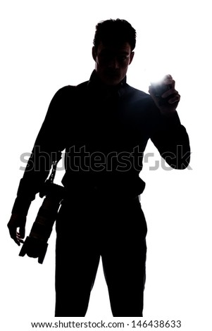 Photographer flashing at the camera in silhouette isolated over white background  - stock photo