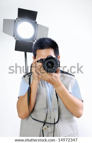 Photographer in action - stock photo