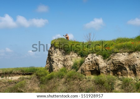 Photographer in action on the sand hill - stock photo