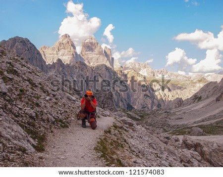 photographer in Mountains - stock photo