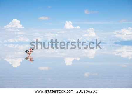 Photographer in salt plain Salar de Uyuni - stock photo