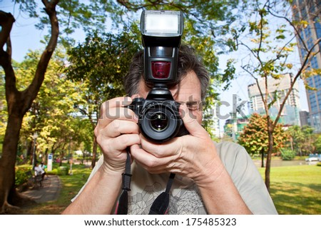 Photographer in the park - stock photo