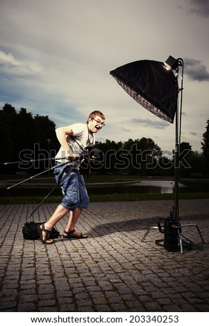 Photographer leaving location - stock photo