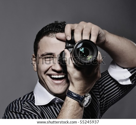 Photographer making a shot - stock photo