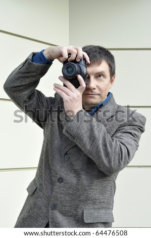 Photographer making a snapshot with retro camera - stock photo