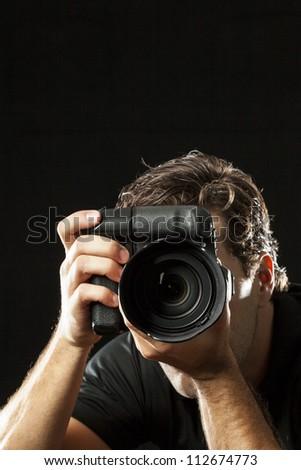 Photographer on black. - stock photo
