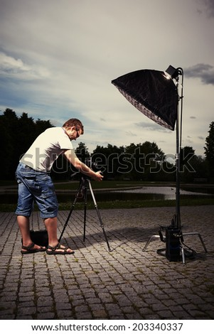 Photographer on location - stock photo