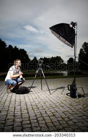 Photographer posing before shooting - stock photo