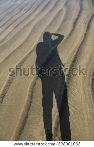 Photographer's shadow. - stock photo