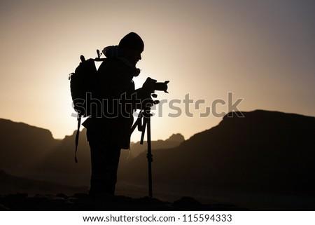 Photographer, sunrise - stock photo