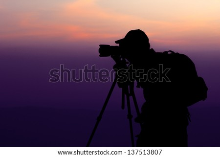 Photographer take a shot at Top of Mountain - stock photo