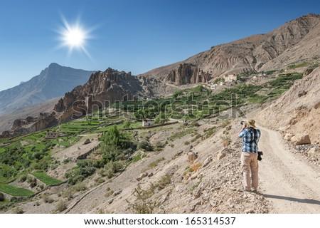 photographer take photo on himalayas mountain - stock photo