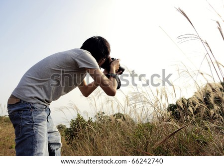 photographer taking photo in country side - stock photo