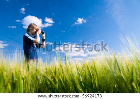 Photographer taking pictures outdoors - stock photo