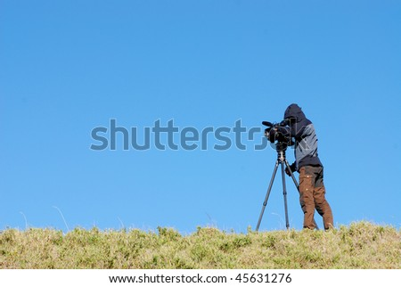photographer used video to shot beautiful scenery. - stock photo