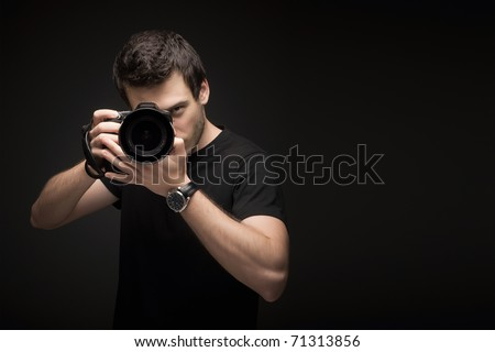 Photographer with camera - stock photo