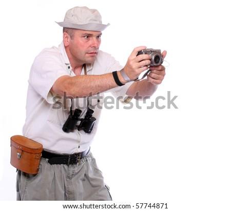 Photographer with camera dressed on safari suit. Studio shot isolated on white - stock photo