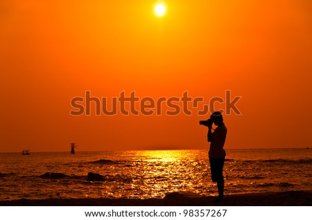 Photographer with sillouette on Hua Hin Beach - stock photo