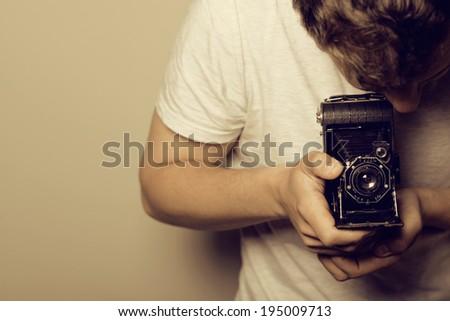 Photographer - Young Man -Retro Shooting - stock photo