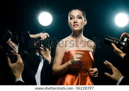 Photographers are taking a picture of a film star - stock photo