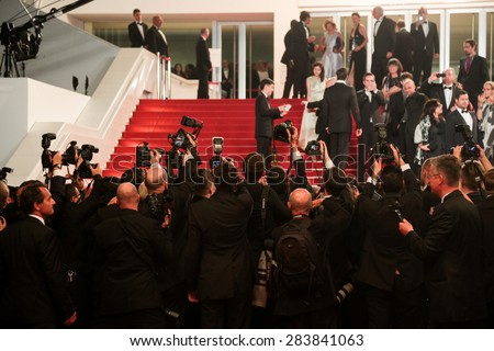 Photographers during the 'Mad Max: Fury Road' premiere during the 68th annual Cannes Film Festival on May 14, 2015 in Cannes, France. - stock photo