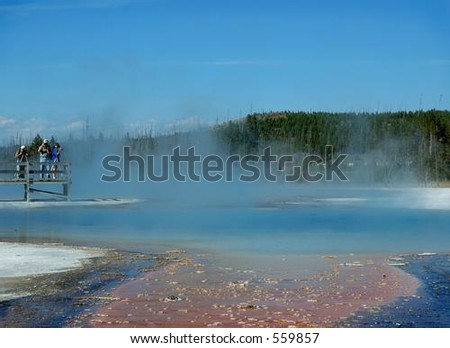 Photographers shooting Jewel Geyser in Yellowstone National Park, Wyoming - stock photo
