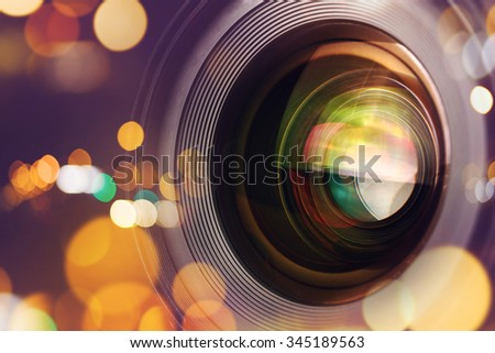 Photographic camera lens front glass with bokeh light, macro shot - stock photo