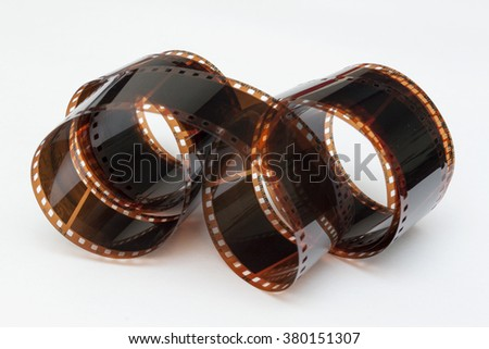 Photographic film in roll with white background - stock photo