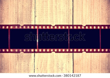 Photographic film on wooden background. Instagram retro vintage picture. - stock photo