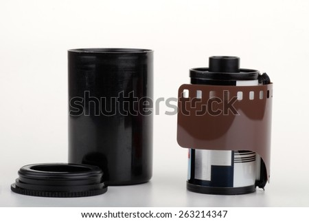 photographic film roll on a white background - stock photo