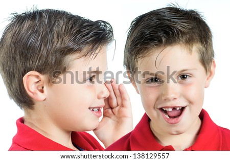 photographic portrait of two children whispering in your ear - stock photo