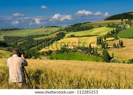 Photographing famous road near small city Monticchiello, Tuscany - stock photo