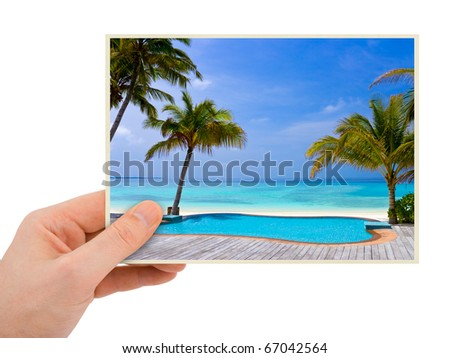 Photography in hand (my photo) isolated on white background - stock photo
