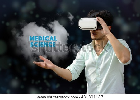 Photography of a man with a Virtual reality. Touching: Medical Science - VR - stock photo