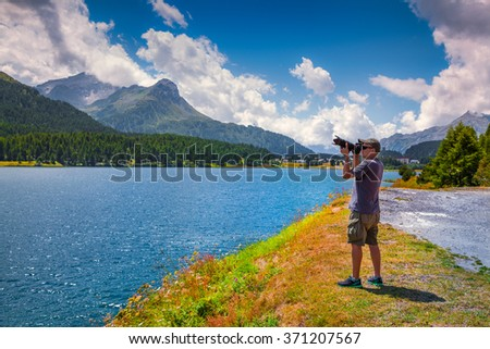 Photograpther take picture on the Silsersee lake. District of Maloja, Swiss canton of Graubunden, Switzerland, Alps, Europe.   - stock photo