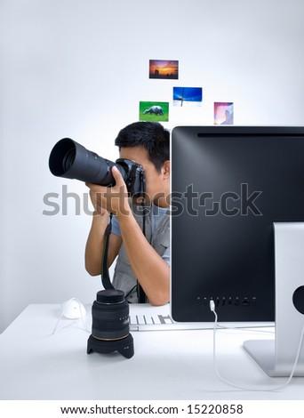 Photojournalist at desk - stock photo