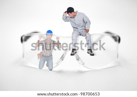 Photomontage of workers with giant goggles - stock photo