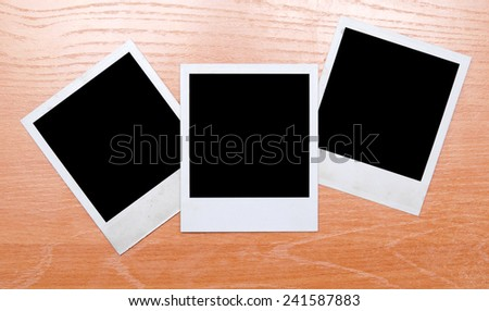 photos on wooden background - stock photo