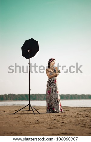 Photoshoot with luxury woman outdoors - stock photo