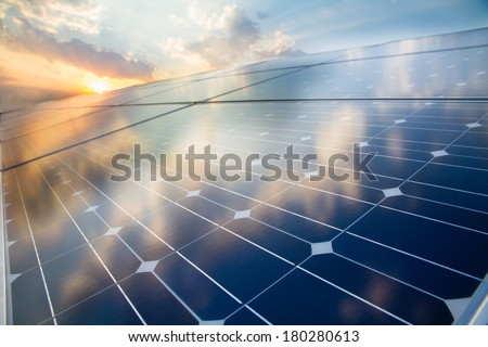 Photovoltaic cell on the background of sunset - stock photo