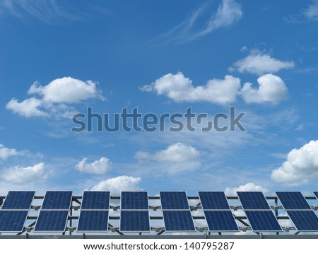 Photovoltaic cells and cloud on a blue sky - stock photo
