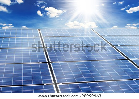 photovoltaic cells and sunlight and sky - stock photo